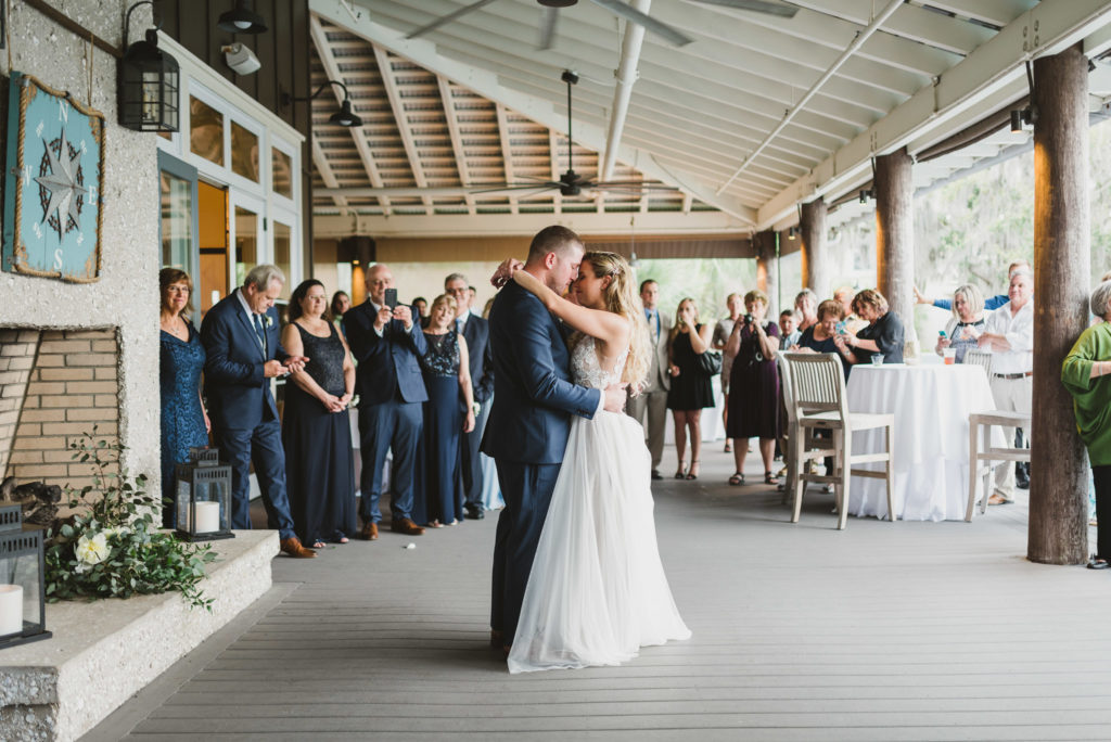 bride and groom dancing at wedding reception at oyster bay yacht club patio