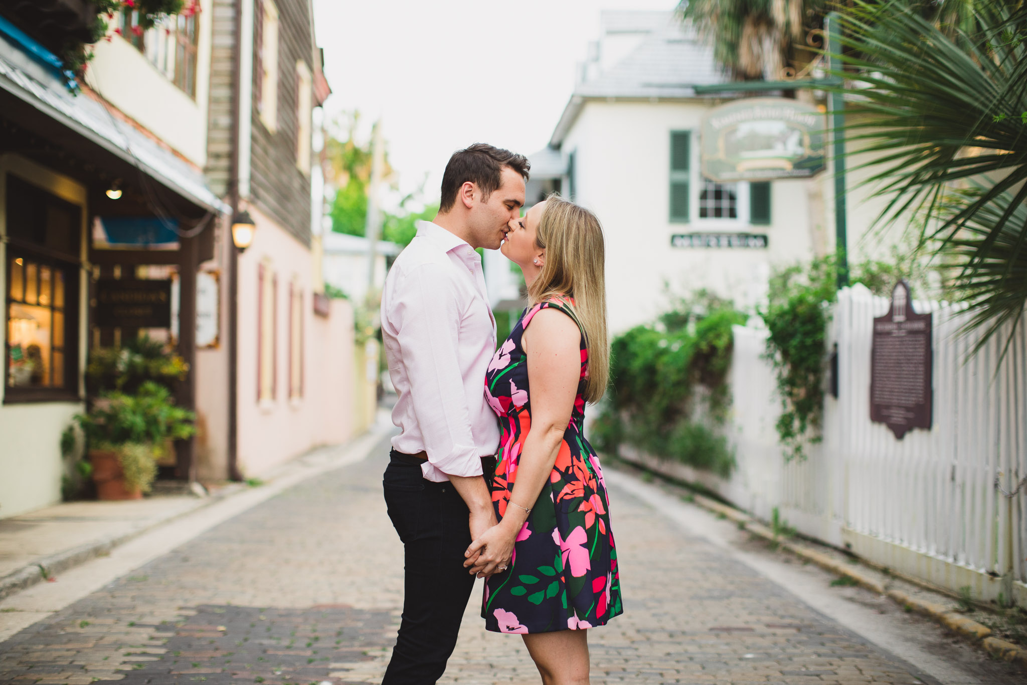 engaged couple kissing on streets of st. augustine