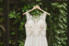 wedding gown hanging on iron gate