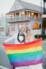 lesbian couple holding gay pride flag in st. augustine street outside villa blanca white room