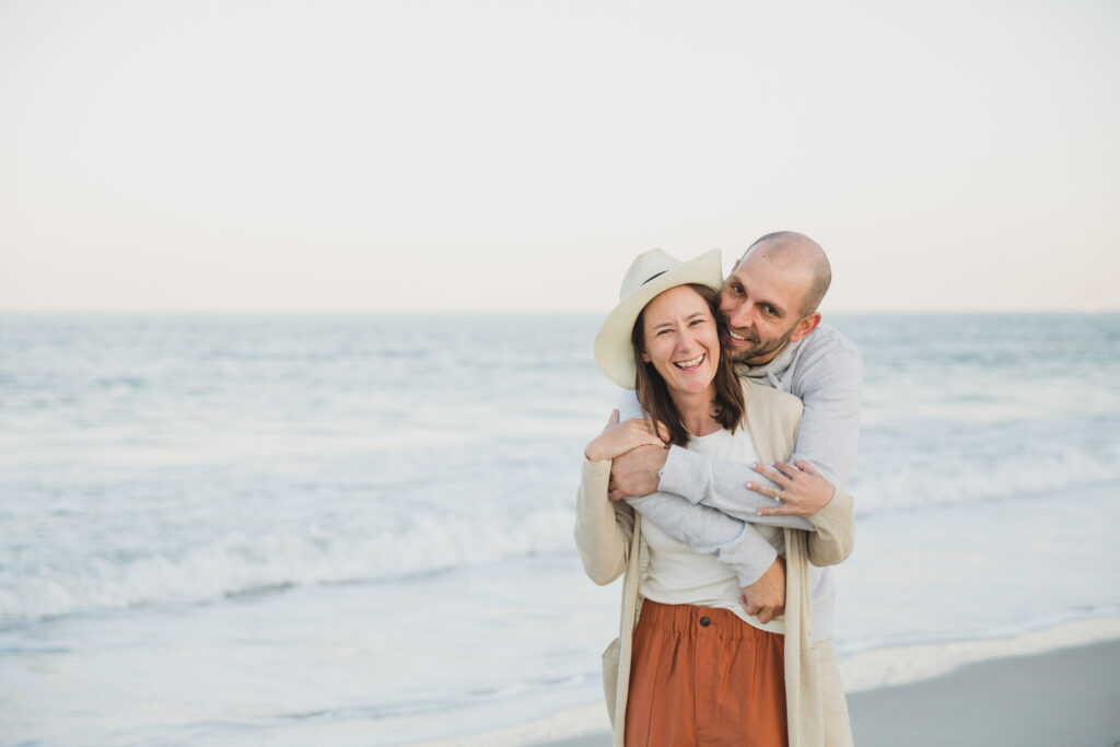 couple in front of ocean on beach for engagement photos