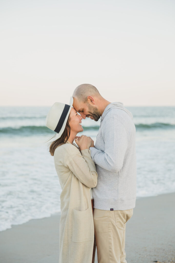 couple getting close during sunset engagement photo session